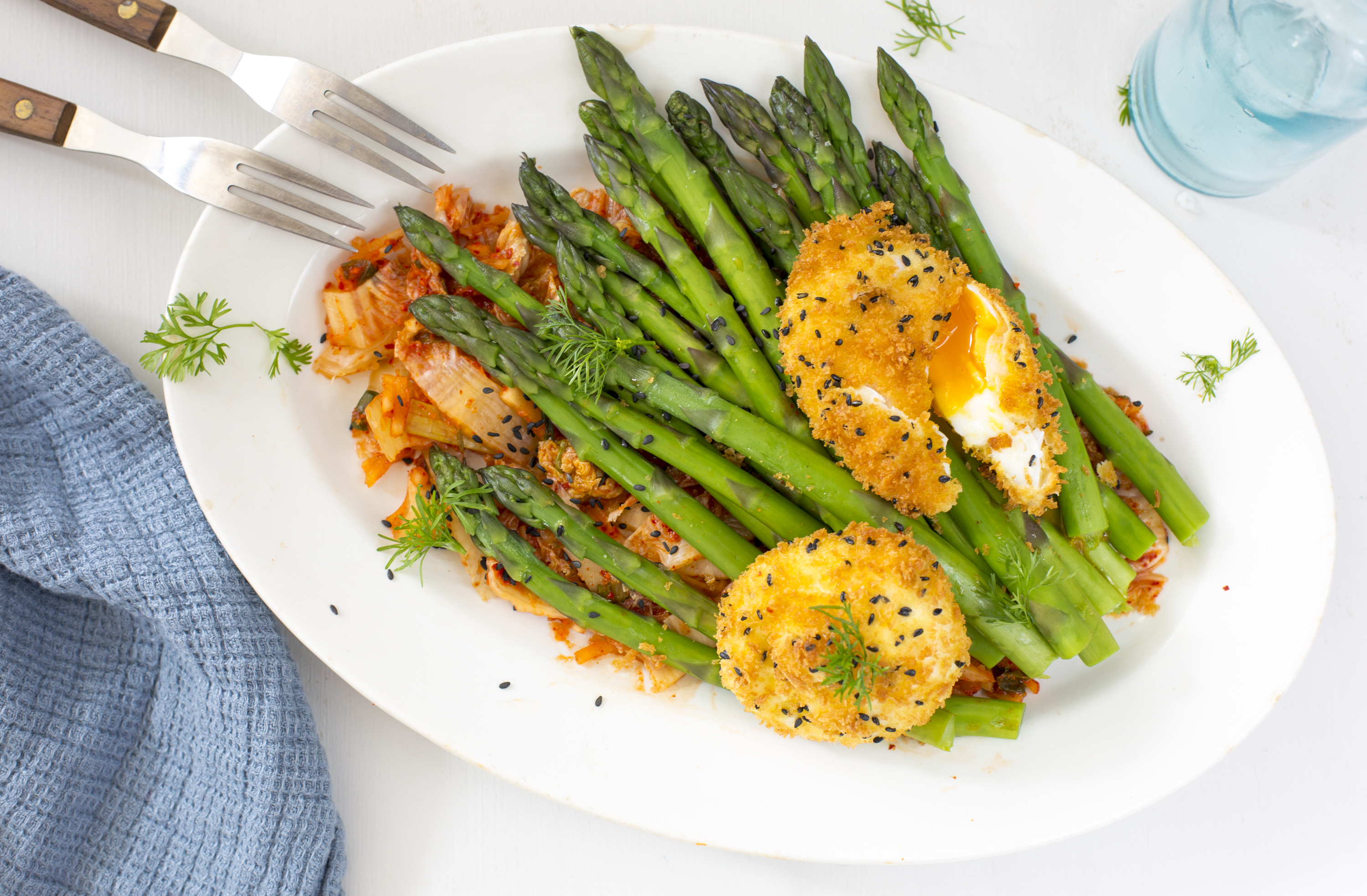 Deep fried eggs with asparagus